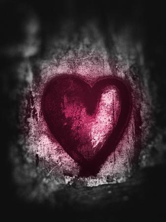 Grunge heart, rough painted heart shape on rough painted concrete texture, grays with magenta tints, blur vignette.