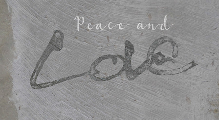 Christmas card with the words Peace and Love, with the Love lettering rough sketch painted on painted concrete surface texture, grays. Reklamní fotografie
