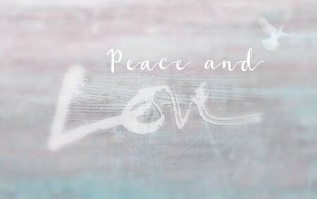 Christmas card with the words Peace and Love, with the Love lettering rough sketch painted style on painted texture background, vignette blur, blue and pink tints, dove image.