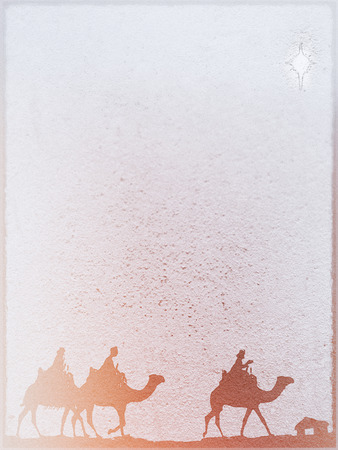 Three Kings Christmas card, design style with silhouettes of the 3 wise men on camels on a rough surface with a single star over a distant barn, with frame effect, rough stone texture and blur vignette, red tints. Stock Photo