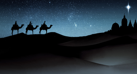 Three wise men Christmas card, with 3 kings on camels traveling on sand dunes, towards an ancient city with a single star above it, in evening light.