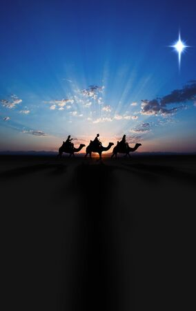Three Kings Christmas card with the 3 wise men on camels on a simple desert landscape with shadows 3D image, with a real sunset and single star, tall. Foto de archivo