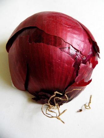 red onion halved, showing the outside. 写真素材