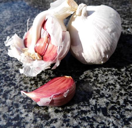 Raw garlic on a chopping board.