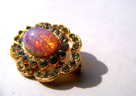Gold brooch with opal and small stones. Banco de Imagens