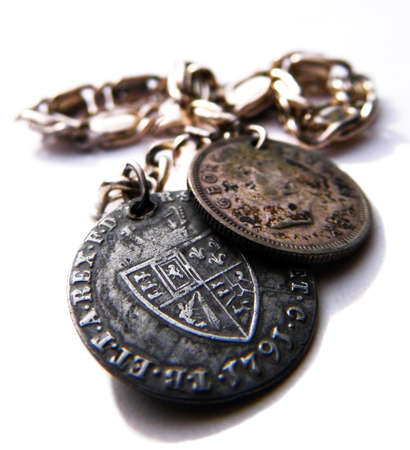 A silver bracelet with old coins, closeup,