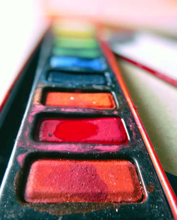 End view of a used box of watercolor paints.