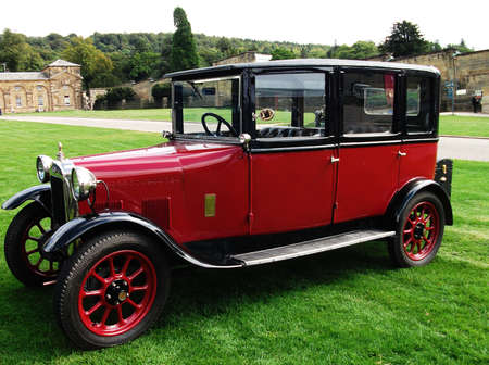 An old vintage car, red and black.