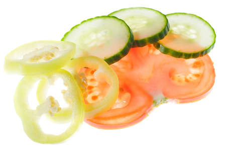 Sliced fresh vegetables - tomato, cucumber, pepper Stock Photo