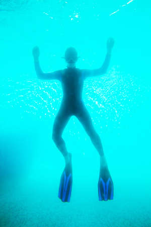 Scuba diver in deep blue water Stock Photo