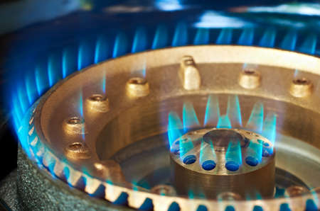 Close-up of a kitchen burner propan-butan blue flame
