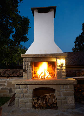 outdoor fireplace: Fireplace in rural house backyard, barbecue grill for roasting food Stock Photo