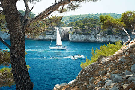 Blue water and boat in Calanque de Cassis, Mediterranean France, region PACA