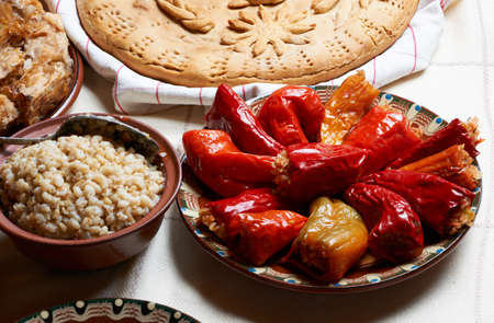 vegeterian: Traditional Bulgarian vegeterian stiffed red peppers in pottery dish