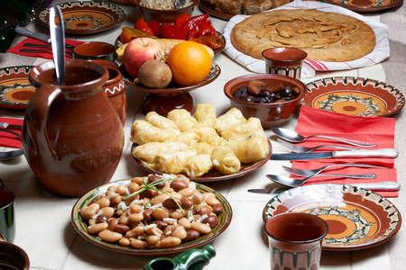 Christmas feast: Table setup for Christmas Eve with traditional Bulgarian vegetarian food