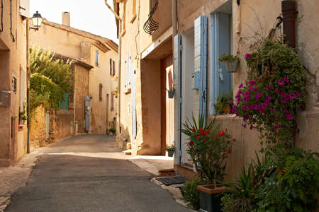 the luberon: Narrow street with typical houses in village of Ansouis, Provence, France, region Luberon