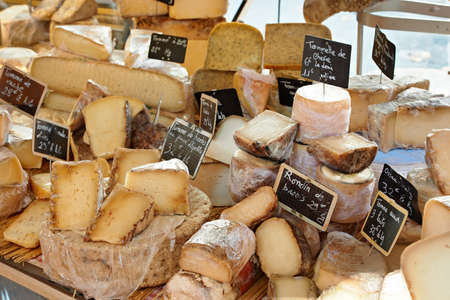 Random French cheese at rural Provence market, town of Aix-en-Provence photo