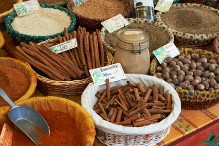 Cinnamon, utmeg, paprica and other exotic spices for sale at Aix en Provence market, South France photo