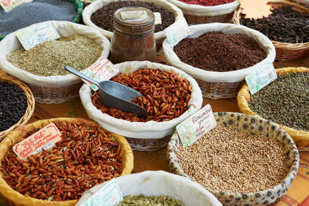 Random spices for sale including coriander, pepper and hot pili-pili at Provence market, South france photo