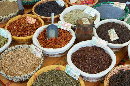 Random types of exotic spices on Provence market in France photo