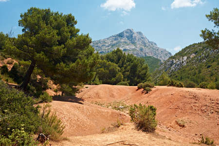 Largest dinosaur fossil find near Aix en Provence with the peak of Saint Victoire mountain, France photo