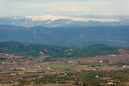 luberon: General landscape view from Luberon region with snow ridges of Alpes, Provence, France in winter season