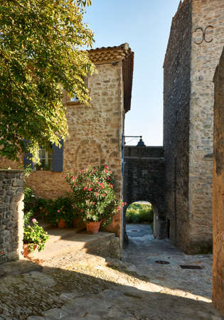 Street with ancient buildings in Grambois village, South France, Provence