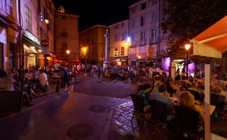 Night life in the restaurants of French town Aix en Provence, Square Place des Augustins