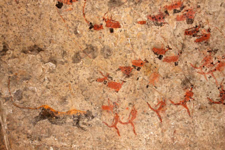 rock painting: Bushmen (san) rock painting of human figures, antelopes and a predator (leopard), South Africa