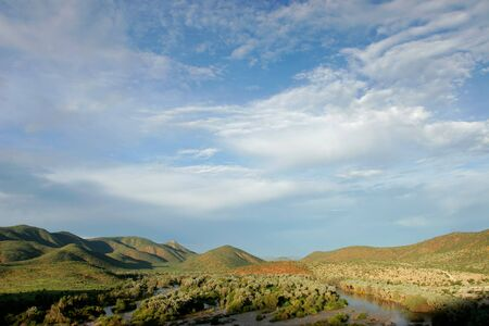 View over  the Kunene river that forms the border between Namibia and Angola, southern Africa