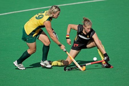 Bloemfontein, South Africa - February 7, 2011 - Tarryn Bright and Anne-Sophie van Regemortel in action during a women's field hockey match between South Africa and Belgium (South Africa won 4-1) Imagens - 9916194