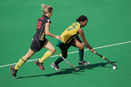 Bloemfontein, South Africa - February 7, 2011 - Charlotte de Vos and Leslie-Ann George in action during a women's field hockey match between South Africa and Belgium (South Africa won 4-1) Stock Photo - 9916312