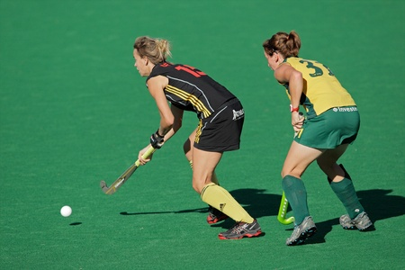 Bloemfontein, South Africa - February 7, 2011 - Charlotte de Vos and Celia Evens in action during a womens field hockey match between South Africa and Belgium (South Africa won 4-1)