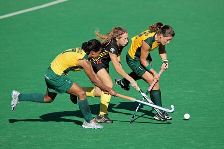 Bloemfontein, South Africa - February 7, 2011 - Ilse Davids, N Nelen and Dirkie Chamberlain in action during a womens field hockey match between South Africa and Belgium (South Africa won 4-1)
