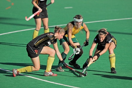 Bloemfontein, South Africa - February 7, 2011 - Anne-Sophie van Regemortel, Lisa-Marie Deetlefs and Gaelle Valcke in action during a womens field hockey match between South Africa and Belgium (South Africa won 4-1)