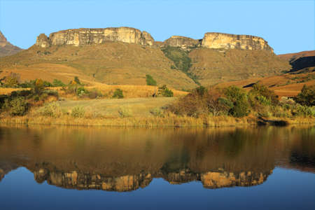 natal: Sandstone mountains with symmetrical reflection in water, Royal Natal National Park, South Africa  Stock Photo