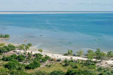 settlement: Aerial view of shallow coastal waters and rural settlement on the tropical coast of Mozambique, southern Africa Stock Photo