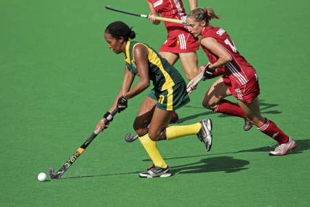 Bloemfontein, South Africa - February 8, 2011 - Leslie-Ann George and Emilie Sinia in action during a womens field hockey match between South Africa and Belgium (South Africa won 3-2)