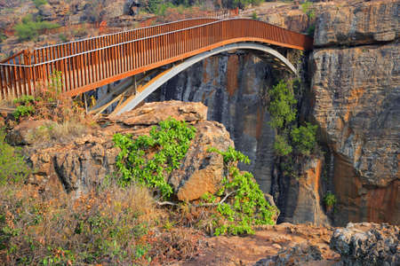 deep south: Bridge over the canyon at the Bourkes Luck potholes in the Blyde river, Mpumalanga, South Africa