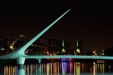tall buildings: Bridge of the Woman  Puente De La Mujer  by night, Buenos Aires, Argentina Stock Photo