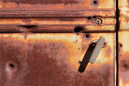 Rusty door of an old pickup truck photo
