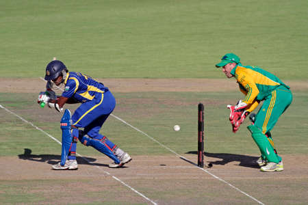 Bloemfontein, South Africa - January 17, 2012 - AB de Villiers (SA) and L Chandimal (SL) during an one-day cricket match between South Africa and Sri Lanka (SA won the match)