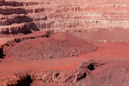open cast mine: Large, open-pit iron ore mine showing the various layers of soil iron rich ore