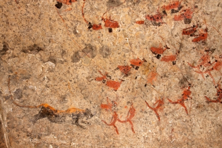 Bushmen (san) rock painting of human figures, antelopes and a predator (leopard), South Africa