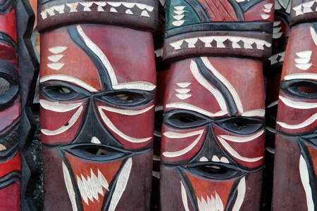 Decorated hand made wooden masks carved from the wood of African trees  Stok Fotoğraf