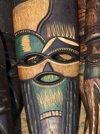 religion ritual: Decorated hand made wooden mask carved from the wood of an African tree