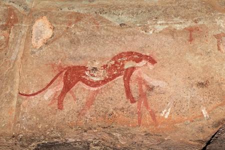 ブッシュマン - サン - 捕食者 (チーター)、ドラケンスバーグ山脈、南アフリカ共和国を描いた絵画を岩します。 写真素材