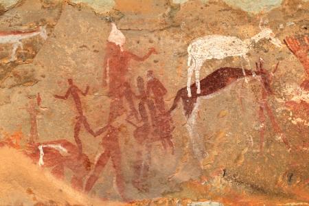 Bushmen - san - rock painting of human figures and antelopes, Drakensberg mountains, South Africa Reklamní fotografie