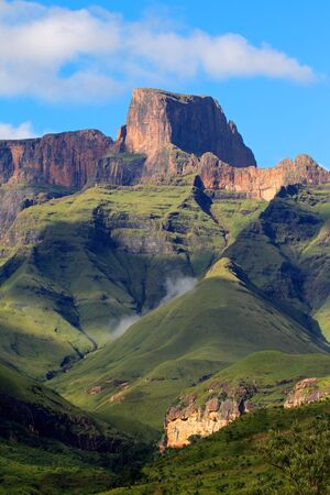 Sentinal peak in the amphitheater of the Drakensberg mountains, Royal Natal National Park, South Africa photo