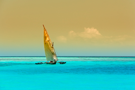 Wooden sailboat  - dhow - on the clear turquoise water of Zanzibar island